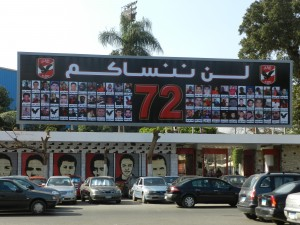 "Billboard for the martyrs of the Port Said massacre of the Ultra Ahli fans at the entrance gate of the Ahli Club, Zamalek island,   Written on top  ""We will not forget you"". Captured 8 February 2013"