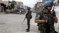 Brazilian UN peacekeepers secure the perimeter of a bank in downtown Port-au-Prince, Haiti. 19/Jan/2010. Port-au-Prince, Haiti. UN Photo/Marco Dormino. www.un.org/av/photo/