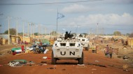 Zambian peacekeepers from the United Nations Mission in Sudan (UNMIS) patrol streets lined with looted items awaiting collection in Abyei, the main town of the disputed Abyei area on the border of Sudan and newly independent South Sudan.