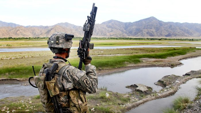 U.S. Army Sgt. David M. Pooler of 1st. Platoon, Able Company, 2-503 Battalion Airborne, 173 Airborne Brigade Combat Team from Vincenza, Italy scans the area across the Kunar river as he provides security iin the Noorgal district on May 01, 2010, Konar province, Afghanistan.  This was part of a community development council meeting.  (U.S. Army photo by Spc. Lorenzo Ware/ Released)