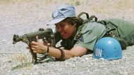 A female member of the Swedish Infantry Battalion attached to UNFICYP on target practice at Battalion Headquarters, Larnaca. The 12 female members of the battalion were the first women to join the Force in Autumn 1979. 1/Jun/1980. Larnaca, Cyprus. UN Photo/John Isaac. www.un.org/av/photo/