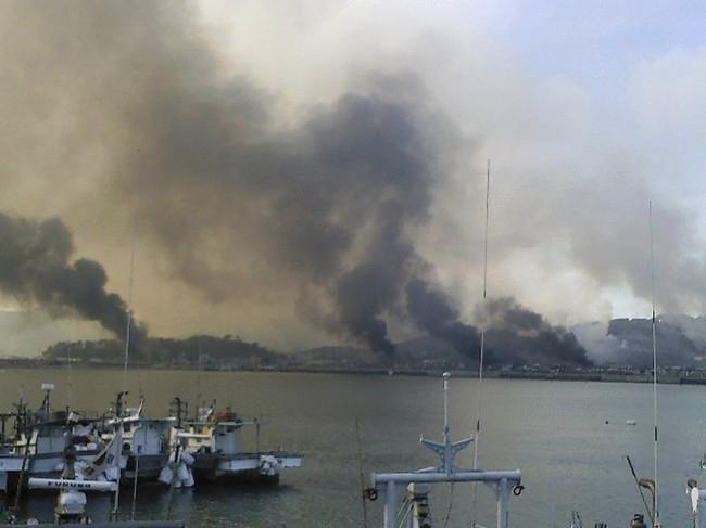 Smoke billowing above Yeonpyeong island, November 2010.