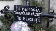 Anniversary of Eastern Europe's bloodiest Revolution reminds of the duty to unearth secrets of the past