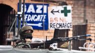 A soldier guards the roadside checkpoint outside of Srinagar International Airport (SXR) in Jammu and Kashmir, India.