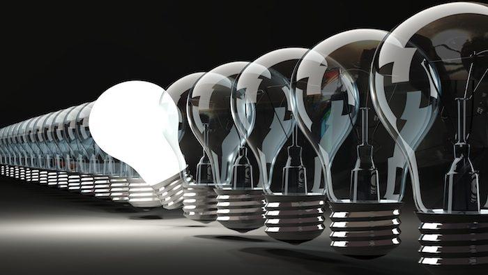 Row of light bulbs on black background