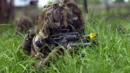 Specialist Eleazar Mattocks, USA, Charlie Company 2-1 Infantry, Fort Wainwright, Alaska, using helmet camouflage and a Colt 5.56 mm M16A2 rifle with an M203 40mm grenade launcher, demonstrates a platoon battle drill attack for the Thai Forces during the COBRA GOLD 2001 exercises. COBRA GOLD '01 is regularly scheduled, joint-combined exercise designed to ensure regional peace and strengthen the ability of the royal Thai Armed Forces to defend Thailand or respond to regional contingencies.  This year's exercise, the 20th in the series, will focus on peace enforcement operations.  (USAF PHOTO BY SRA LESLIE LAWRENCE 010517-F-1379L-004)