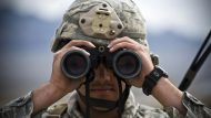 U.S. Air Force Senior Airman Brent Glover, 822nd Base Defense Squadron, Moody Air Force Base, Ga., looks through binoculars during a field training exercise on the Nevada Test and Training Range as part of exercise Desert Eagle March 16, 2011. Desert Eagle is a joint training event with the RAF and the Air Force's 820th BDG designed to improve interoperability during contingency operations.