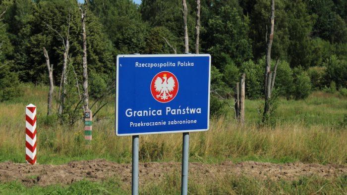 """Republic of Poland's National Border - crossing forbidden"" - Polish road sign at the border with Russia (Kaliningrad Oblast)"